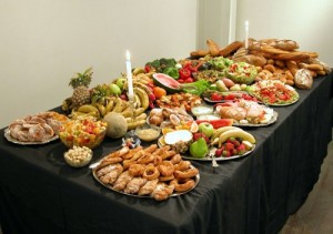 gdevietri-Dumpster-Feast-2004-Food-recovered-from-supermarket-and-shop-bins-over-one-day-silverware-candles-table-tablecloths-500x352